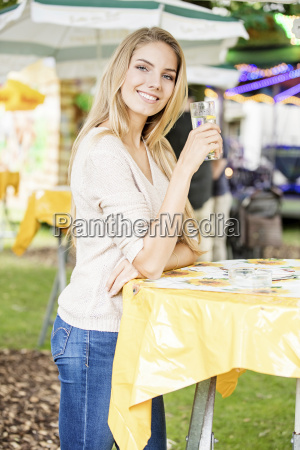young woman drinking beverage at a