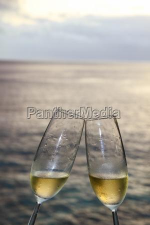champagne flute against beach