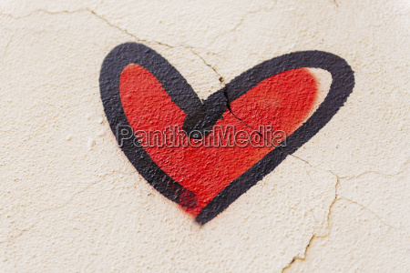 red heart painted on a wall