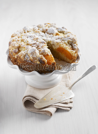 peach crumble cake with napkin and