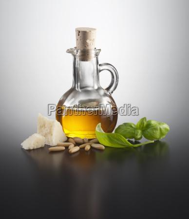 ingredient pesto on coloured background close
