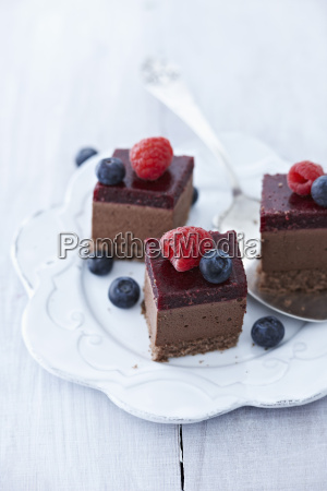 choco cheesecakes with raspberry and blueberry