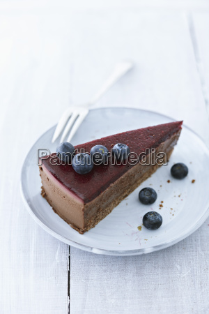 cheesecake with blueberries on plate close