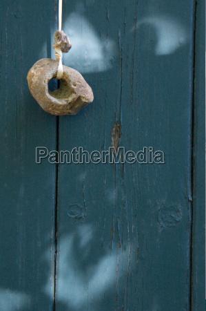 breton adder stone hanging in front