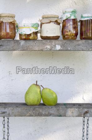 row of preserving jars of pear