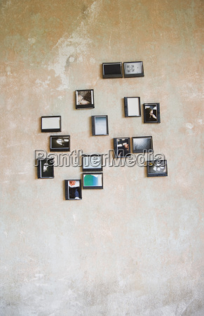 instant photos in upcycled plastic boxes