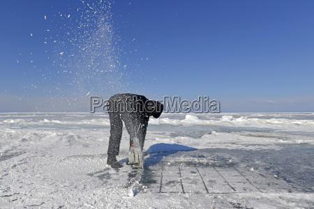 russia lake baikal man opening an
