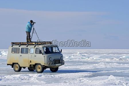 russia lake baikal man with telescope
