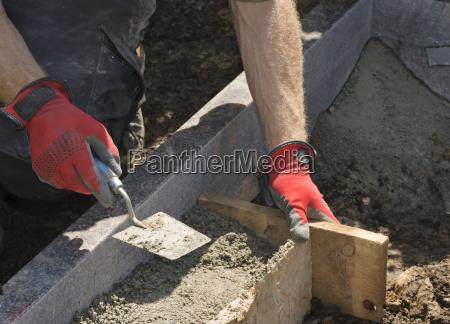 stonemason working on a grave