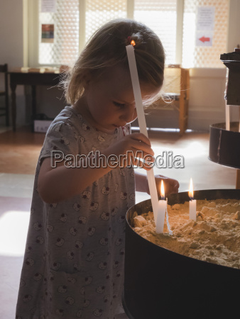 little girl with candle in a