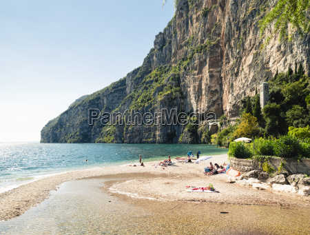 italy lake garda people sunbathing at