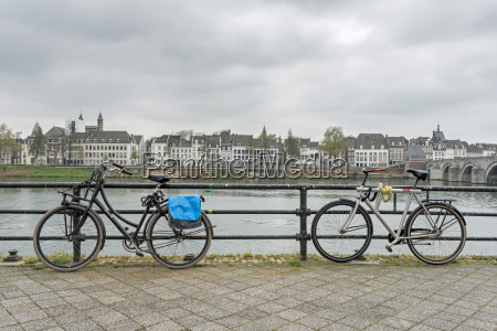 netherlands maastricht meuse river parked bicycles