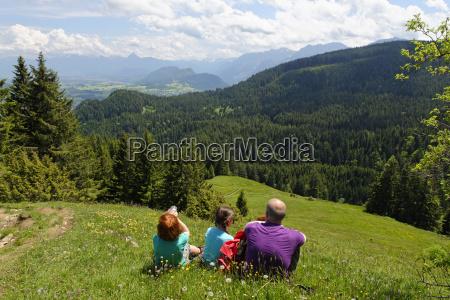 germany bavaria allgaeu hikers resting at