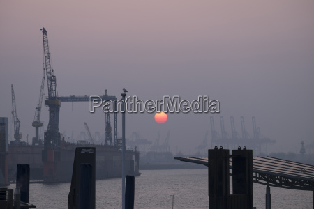 germany hamburg sunset at container harbor