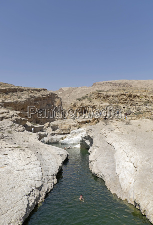 oman people bathing at wadi bani