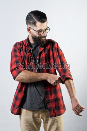 hipster rolling up his sleeve
