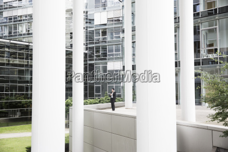 businesswoman standing in front of office