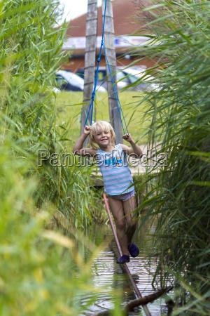 little girl balancing at climbing crag