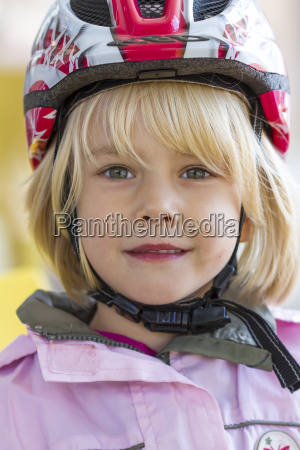 portrait of little girl with cycling