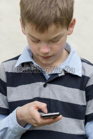 boy using mobile phone close up