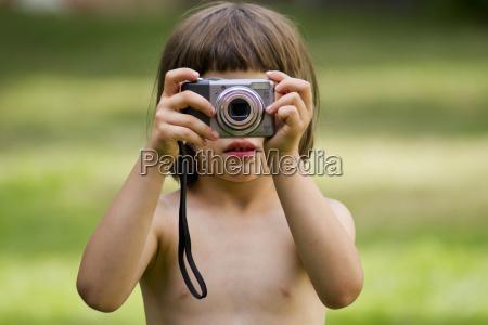 germany tuebingen girl topless holding camera