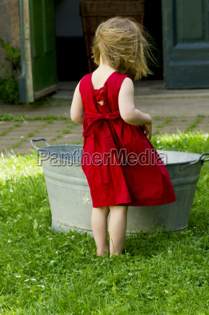 germany girl standing in garden