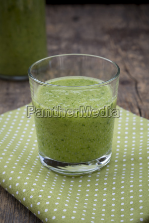 glass of green smoothie made of