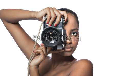 portrait of woman with camera in