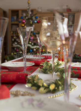 dining table with glasses dishes napkins