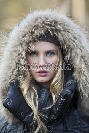 portrait of young woman wearing hooded