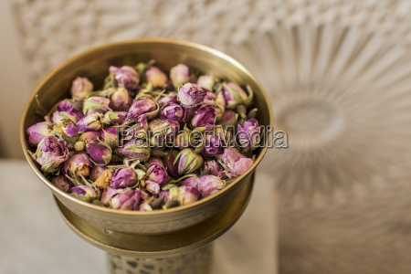 vessel of dried rose blossoms
