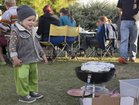 toddler at a barbecue on a