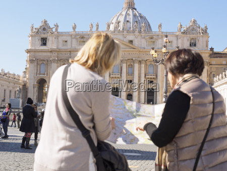 italy rome tourists with map in