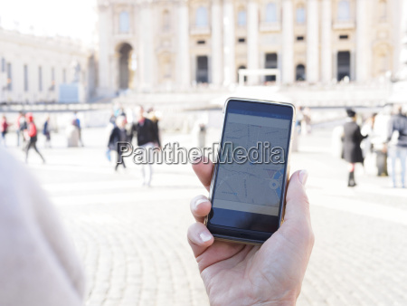 italy rome woman holding mobile with