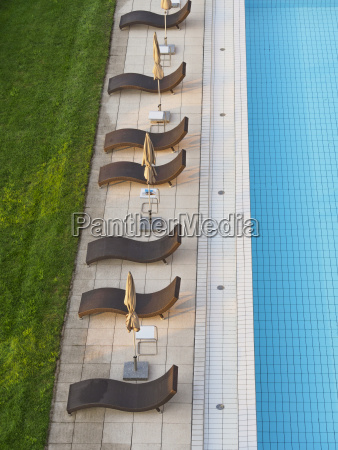 empty sun loungers at the poolside