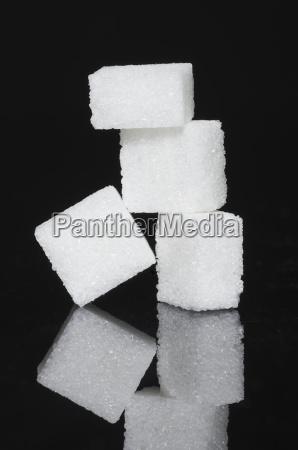 stack of sugar cubes on black