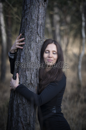 austria young woman hugging a tree