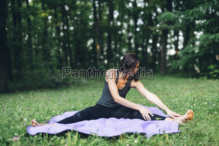 young woman stretching out in nature
