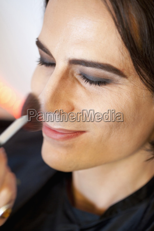 man applying make up close up