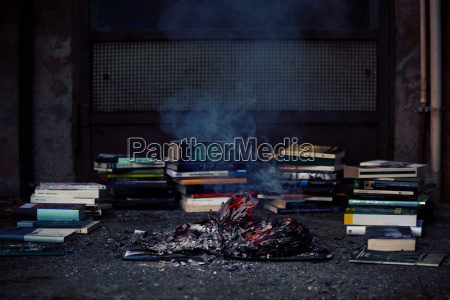 stack of books fireplace burnt book