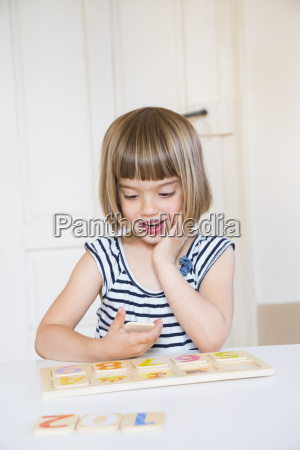 portrait of little girl learning figures