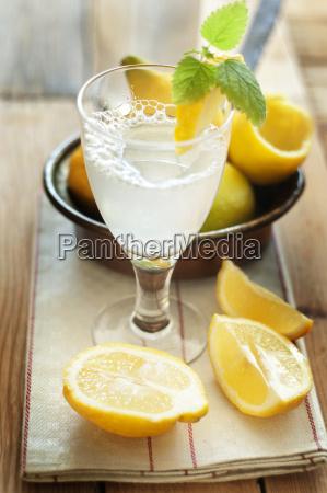 lemon soda on napkin with lemon