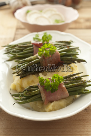 plate of beans with raw ham