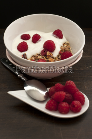 bowl of muesli with raspberries on