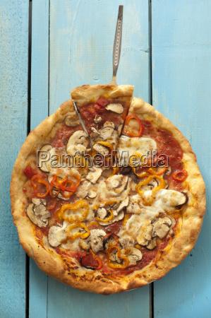 pizza with curcuma mozzarella pepper and