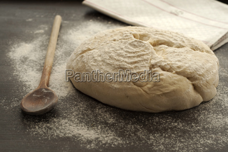 white bread with wooden spoon on