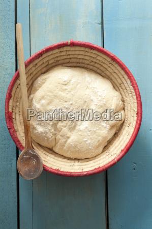 bowl of white bread dough on