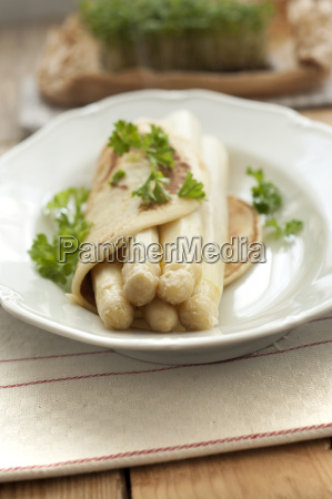 asparagus with pancake on plate close