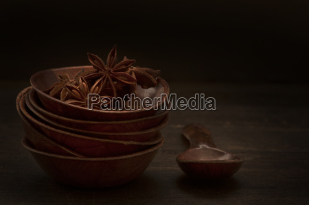 bowl of star anise with wooden