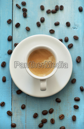espresso with coffee beans on wooden